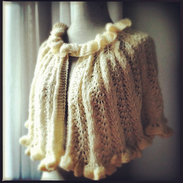 Candy knitted her very own wedding capelet!  :-)